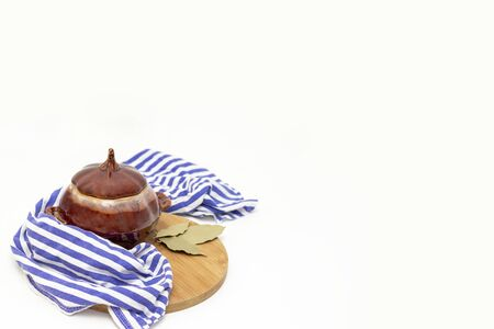 cooking in the oven. clay pots for cooking. food concept. on a white background. copy space