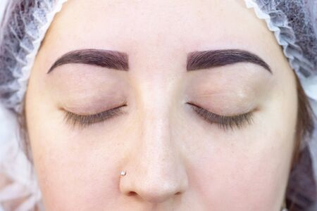 dyeing and eyebrow shaping. the result of the wizard. girl in a beauty salon
