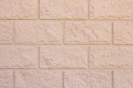 Brick wall background texture. Exterior wall decoration and design. beige