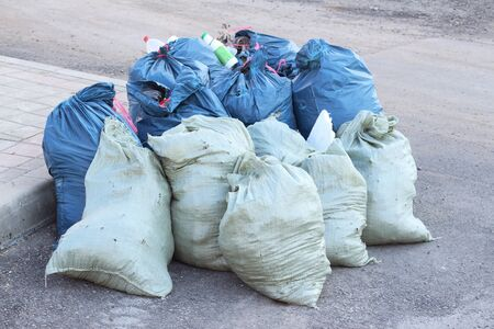 trash piled up in bags garbage disposal a lot of garbage utilization of wastes dump junkyard territory cleaning yard