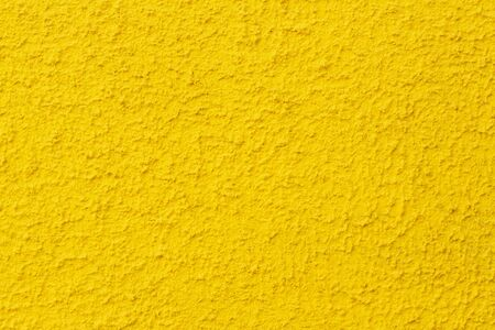 yellow wall texture background. Photo of yellow textured plaster wall.