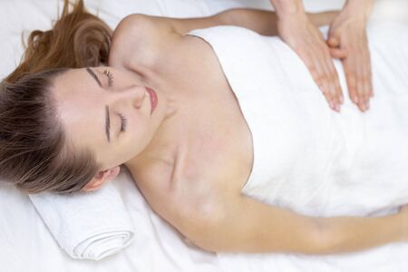 Massage Therapist Massaging a Womens Stomach. Massage and body care. Spa body massage woman hands treatment.