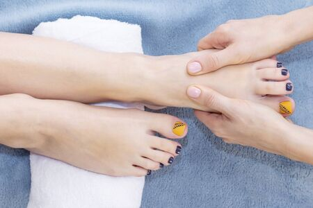 Foot massage in spa salon, closeup. foot massage relax skin care.