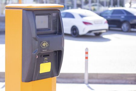 wireless parking management system, automatic gates and barriers, parking entrance security system. Coin ticketing machine payment station for parking on the roads.