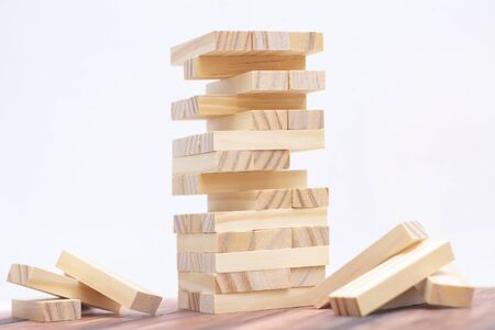 Close-up of a light wooden tower made of blocks. Stock Photo