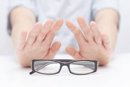 Refusal of glasses for sight. hands refuse glasses. cross on glasses. Vision improvement, laser vision correction.