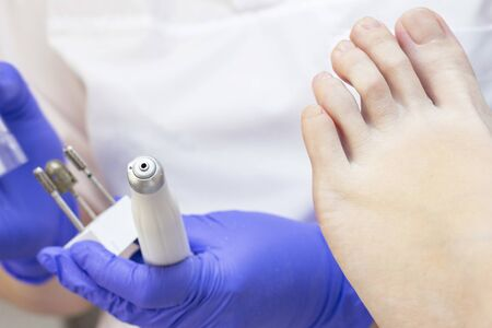 Therapeutic pedicure. Master podologist does hardware pedicure. visit to the podiatry. Foot treatment in the spa. Clinic of Podiatria.