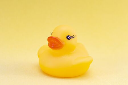 Rubber duck on a yellow background minimally creative concept. bathing babies