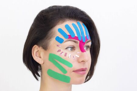 Face taping, close-up of a girls face with cosmetological anti-wrinkle tape. Face aesthetic taping. Non-invasive anti-aging lifting method for reduction of wrinkles