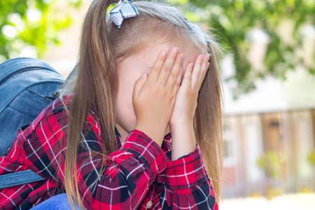 schoolgirl is crying, bullying at school, a quarrel between classmates. Banque d'images