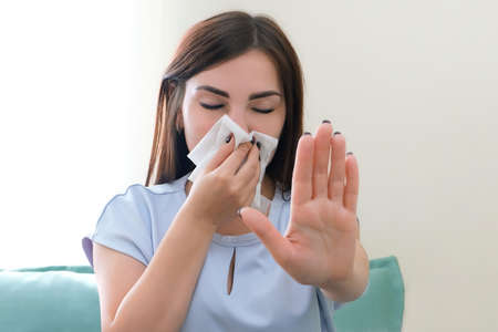 allergy in a young woman. Young woman with a scarf on her nose. stop allergy Foto de archivo