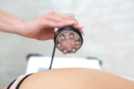Rf lifting procedure on the legs, buttocks and back, hips of a woman in a beauty parlor. Treatment of overweight and flabby skin.