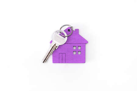 figure of a mini house of purple color with keys on an isolated white background.
