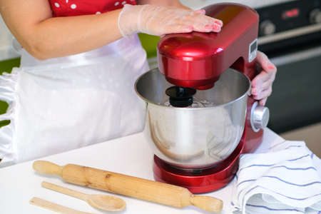Beaten egg whites until frothy. Whipped egg whites for a meringue. Red stationary mixer, food processor