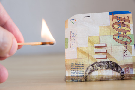 burning money: Match next to one hundred nis bill