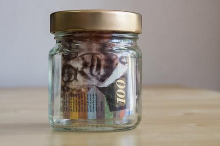 Money locked in a jar