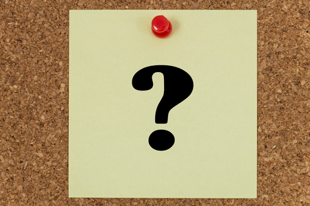 postit: Question mark written on a note