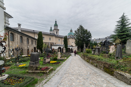 Visiting Petersfriedhof cemetry in Salzburg, Austria Stock Photo