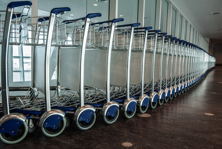 facilitation: Airport trolleys queued one by one.