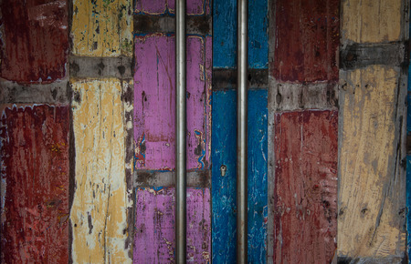 Aged doors, of a bar in Bali, indonesia. Long metal handles, and aged colored wooden door. photo