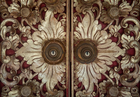 wicket gate: Traditional Balinese carved doors. A real masterpiece of traditional design. Stock Photo