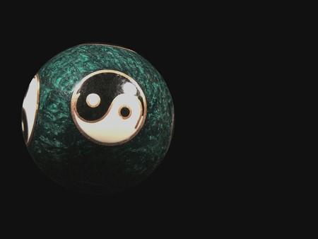 continuum: Yin Yang Sphere on Black background Stock Photo