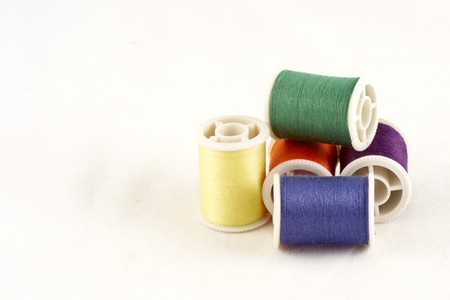 Pile of 5 spools of thread Stock Photo