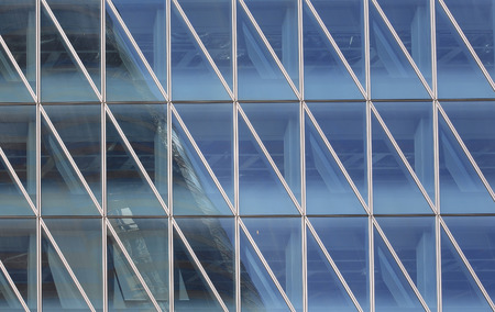 Abstract triangles windows with the reflection of other buildings in hong kong city,Central financial zone photo