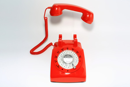 hang up: Retro rotary dial phone on call with no body, hang up by hollow man Stock Photo