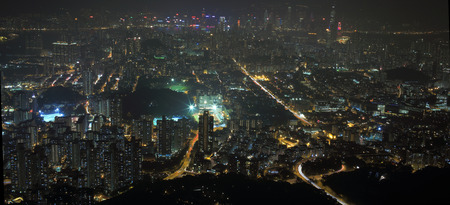 the bird view of  Kowloon Peninsula urban area, coast to coast the hong kong island and victoria harbour harbor photo