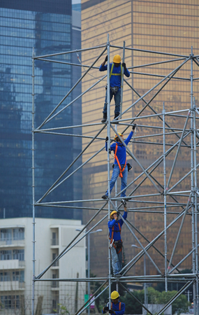 rigger: HONG KONG NOVEMBER 30: Workers are scaffolding on the site in Central on 30 nov 2013.