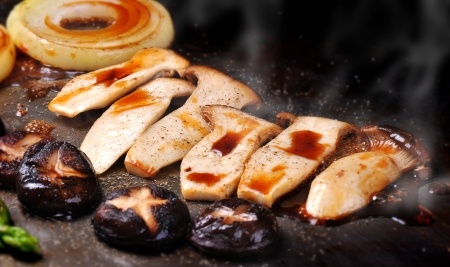 Close up grilled mushroom and onion with Japanese sauce photo