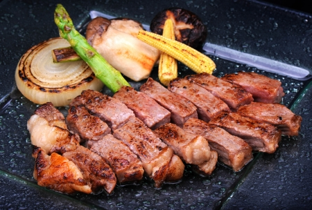 japanese cooking: Grilled Kobe Miyazaki beef decorate with grilled onion, sweet corn, mushroom and Asparagus Stock Photo