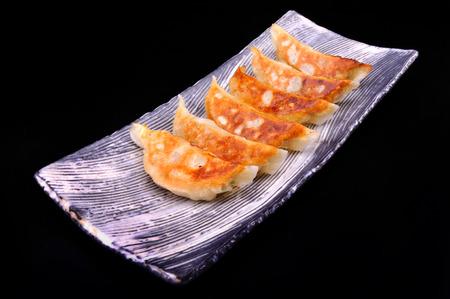 plato del buen comer: hambre comer gyoza Foto de archivo
