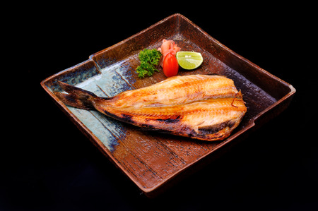 sutra: Japanese Shimahokke firh grill serve in old plate Stock Photo