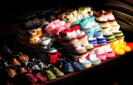 baby shoe: Baby shoe in sunset time nearly time to close shop