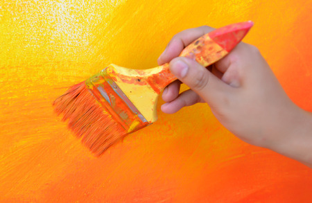 artist: hand on color brush paint mix work on time Stock Photo