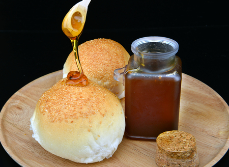 serv: sticky of  sweet honey and breads ready to serv Stock Photo