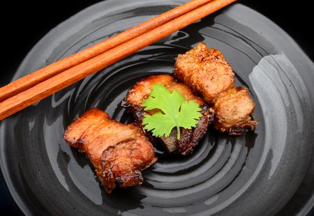 serve: fried pork with garlic serve asian style