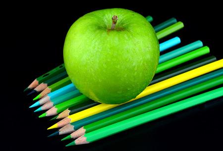 green tone: green apple and color pencils green tone