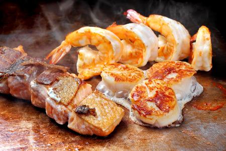 hotate: Japanese teppanyaki fried seafood mix hot on plate good smell