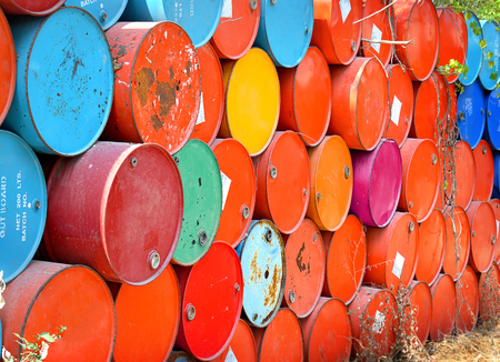 brent crude: colorful of old oil tanks after uesd in outdoor day light