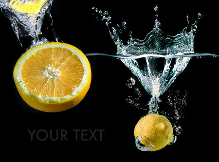 splash mixed: Splash water with droping lemon and slice piece in art mixed whith space for text in studio technical speed and lighting.