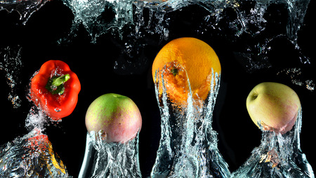 splash mixed: Splash water with droping oranges,bell pepper and apples in art mixed in studio technical speed and lighting.