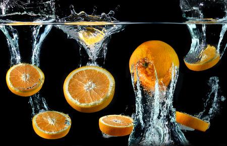 splash mixed: Splash of water droping oranges and art mixed in studio technical speed and lighting.