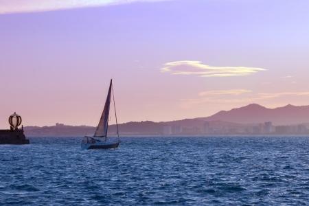 The Evening in Spanish bay, sailboat leaves on sundown.