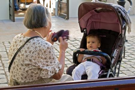 Grandmother and grandchild play outdoors, Barselona, autumn 2011