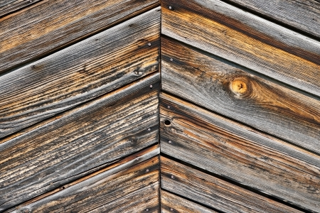 Old weather-beaten boards, element of the sheeting of the lodge Stock Photo