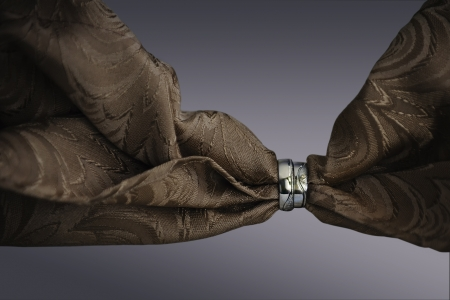 Fabric threaded through the wedding rings Stock Photo - 18920142