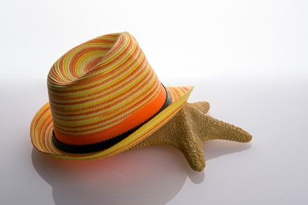 Starfish lying under a straw hat Stock Photo - 21091160